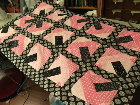 pink and black quilt top
