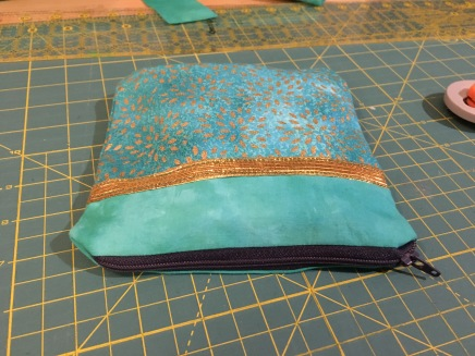 zippered bag on a fabric cutting mat