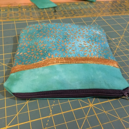 zippered bag on a fabric cutting mat