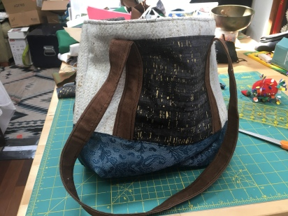 Tote bag with blue bottom, brown straps